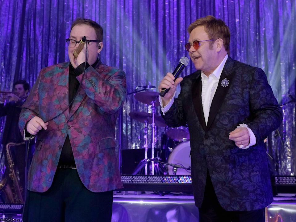 Paul Janeway and Elton John perform together. (Photo: Dimitrios Kambouris/Getty Images for EJAF)