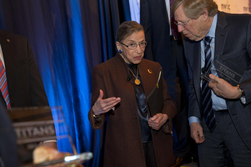 Supreme Court Justice Ruth Bader Ginsburg, left, talks with former Solicitor General Ted Olson, after she spoke to the Northern Virginia Technology Council, Tuesday, Dec. 17, 2013, in Reston, Va. (AP Photo/Jacquelyn Martin)