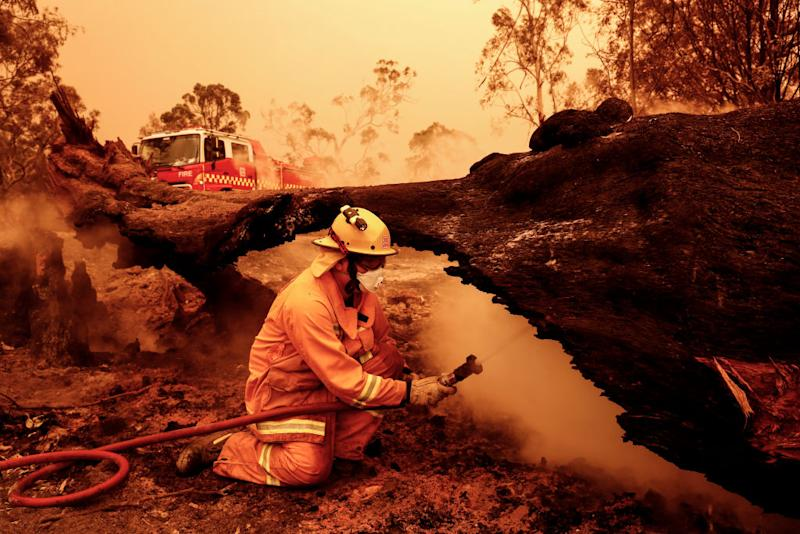 Fire crews put out spot fires on January 04, 2020 in Sarsfield, Australia