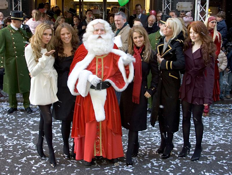 Girls Aloud open the Harrods Christmas Grotto, accompanied by Mohamed Al Fayed.Picture: UK Press