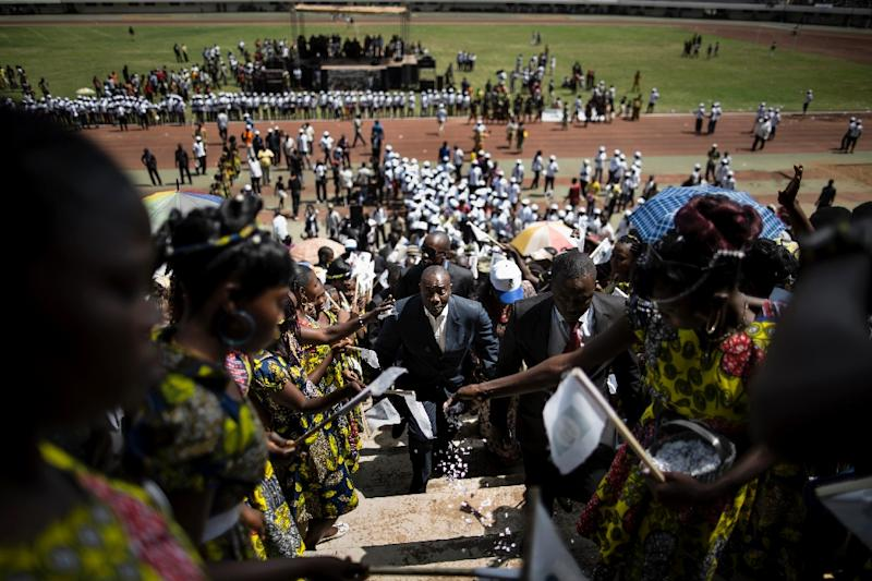 Karim Meckassoua, an independent candidate supported by the National Unity Party, walks through the stadium in Bangui on December 5, 2015 (AFP Photo/Marco Longari)