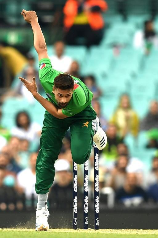 Pakistan's paceman Mohammad Amir in action during the Twenty20 match against Australia (AFP Photo/Saeed KHAN)