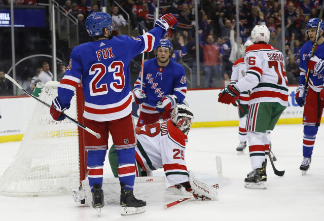 New York Rangers defenseman Adam Fox (23) celebrates after scoring against New Jersey Devils goaltender Mackenzie Blackwood during the first period of an NHL hockey game Saturday, Nov. 30, 2019, in Newark,N.J. (AP Photo/Noah K. Murray)