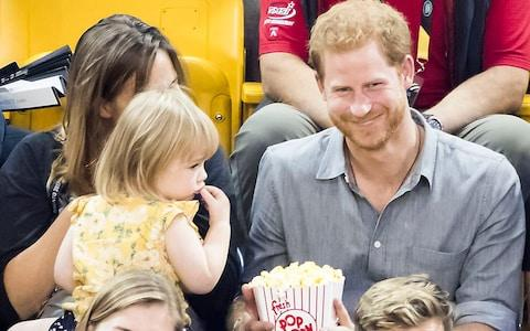 Harry shares his popcorn with Emily Henson.... after she helps herself - Credit: Danny Lawson/PA