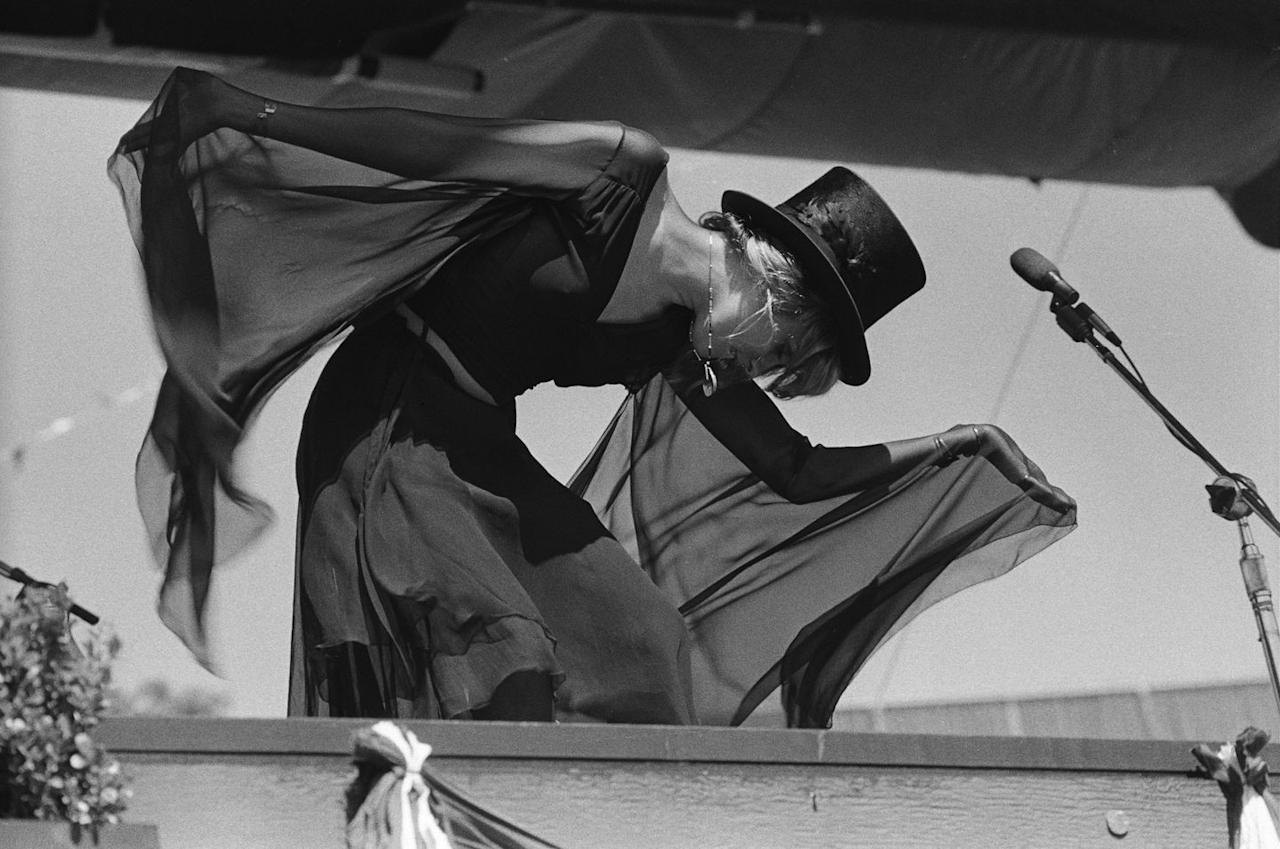 <p>The Fleetwood Mac performer's sleeves wave in the wind as she dances at The Oakland Coliseum in California, circa 1977.</p>