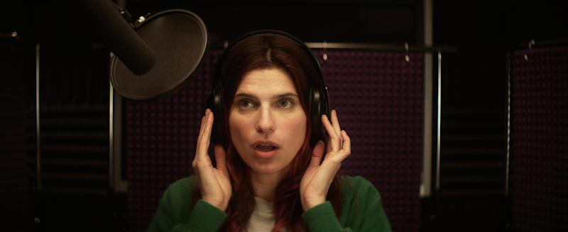 "This publicity photo released by Roadside Attractions shows Lake Bell in a scene from the film ""In a World...,"" a comedy about a struggling voice coach. Written and directed by Bell, who also stars in the film, it won the Sundance 2013 Waldo Salt Screenwriting Award for the script. Real voice-over artists, the men and women who've spent years invisibly announcing the latest Taco Bell temptation, the promise of Firestone tires or upcoming Lifetime programs, who've seen the film (which expands to more than 30 locations Aug. 16, 2013) say it's great to watch their profession on screen. (AP Photo/Roadside Attractions, Seamus Tierney)"