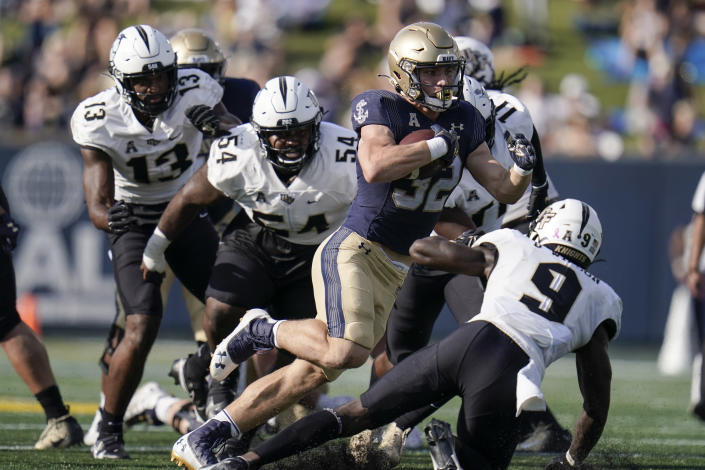 Navy fullback Isaac Ruoss runs with the ball against UCF during the first half of an NCAA college football game, Saturday, Oct. 2, 2021, in Annapolis, Md. (AP Photo/Julio Cortez)