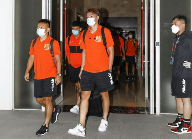Out at last! Chinese football teams exit 70-day virus 'bubble'
