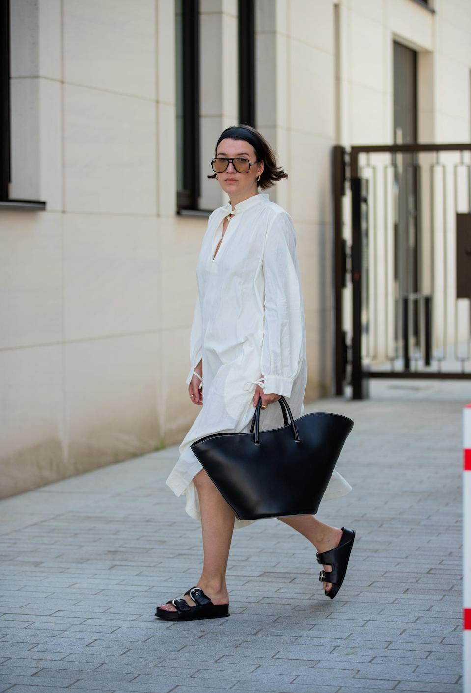 <p>Wear an unstructured shirtdress with an oversize bag and slide sandals.</p>