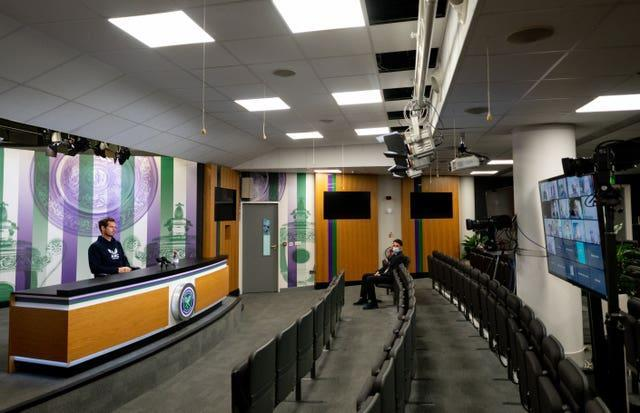 Andy Murray sits in an empty media room, with all press conferences being conducted virtually