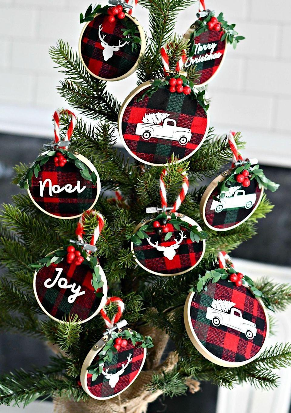 """<p>There's something about flannel that has the word """"Christmas"""" written all over it—so what better fabric to incorporate into your ornaments? For another rustic touch, add your favorite iron-on decals.</p><p><strong>Get the tutorial at <a href=""""https://hip2save.com/diy/diy-embroidery-hoop-christmas-ornaments/"""" rel=""""nofollow noopener"""" target=""""_blank"""" data-ylk=""""slk:Hip2Save"""" class=""""link rapid-noclick-resp"""">Hip2Save</a>.</strong></p><p><a class=""""link rapid-noclick-resp"""" href=""""https://www.amazon.com/Robert-Kaufman-Mammoth-Flannel-Buffalo/dp/B0130EH33Y/ref=sr_1_3?tag=syn-yahoo-20&ascsubtag=%5Bartid%7C10050.g.1070%5Bsrc%7Cyahoo-us"""" rel=""""nofollow noopener"""" target=""""_blank"""" data-ylk=""""slk:SHOP FLANNEL FABRIC"""">SHOP FLANNEL FABRIC</a></p>"""