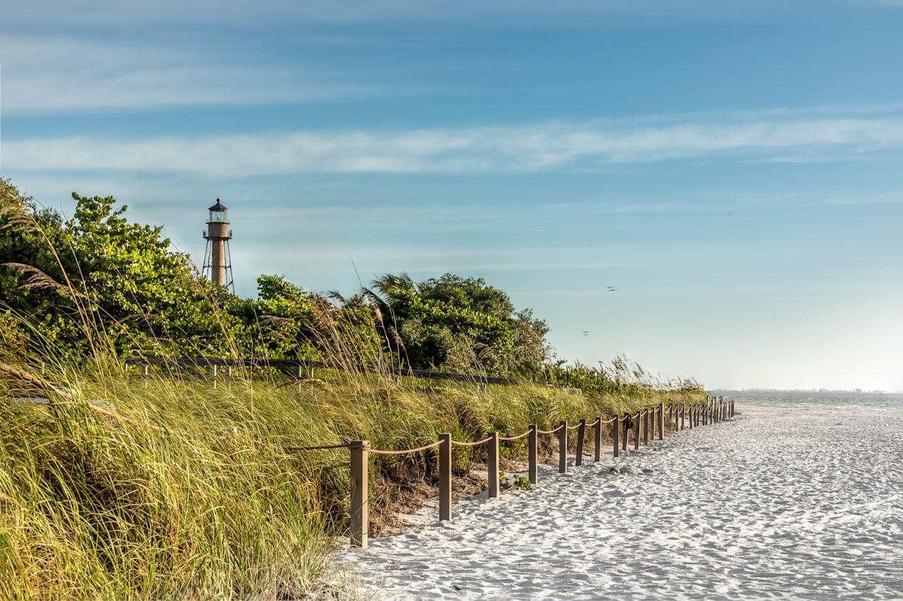 """<p>With no buildings over two stories and two-thirds of the island protected for conservation, Sanibel Island is serious about preserving its natural beauty. This barrier island on Florida's southern Gulf shore is known as one of the best spots in the United States for gathering seashells.</p> <p><strong>Pro tip:</strong> When you've had enough of sand and shells, head to the J.N. """"Ding"""" Darling National Wildlife Refuge, which occupies over half the island. Hit the kayaking trails to spot the manatees, sea turtles, and more than 200 species of birds that live nearby.</p> <p><strong>Getting there:</strong> Fly into the Southwest International Airport in Fort Myers, which has nonstop service from a number of cities on the East Coast and in the Midwest. From there, it's a 45 minute drive to Sanibel Island with causeway access.</p>"""