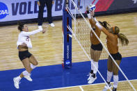 Wisconsin's Molly Haggerty (23) scores a point against Texas' Jhenna Gabriel (2) and Asjia O'Neal (7) during the first set of a semifinal in the NCAA women's volleyball championships Thursday, April 22, 2021, in Omaha, Neb. (AP Photo/John Peterson)