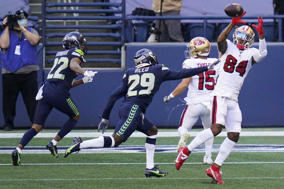 San Francisco 49ers wide receiver Kendrick Bourne (84) makes a catch in front of Seattle Seahawks defensive back Jayson Stanley (29) during the first half of an NFL football game, Sunday, Nov. 1, 2020, in Seattle. (AP Photo/Elaine Thompson)