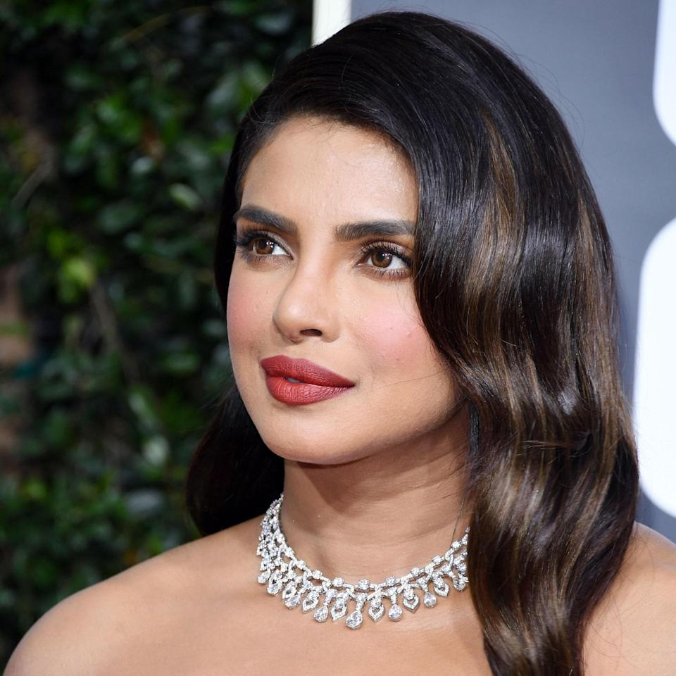 """Deep whiskey, chunky highlights placed throughout Priyanka Chopra's hair cut through her dark strands but still read classic brunette. """"This really works on her skin tone because it's not overly warm or light,"""" says Bodt. """"When lifting dark hair, it can be more open to getting dingy or brassy,"""" she continues. """"I love using apple cider vinegar rinses like <a href=""""https://shop-links.co/1700788710896786816"""" rel=""""nofollow noopener"""" target=""""_blank"""" data-ylk=""""slk:R+Co Acid Wash"""" class=""""link rapid-noclick-resp"""">R+Co Acid Wash</a> [before shampoo and conditioner] to remove those minerals."""