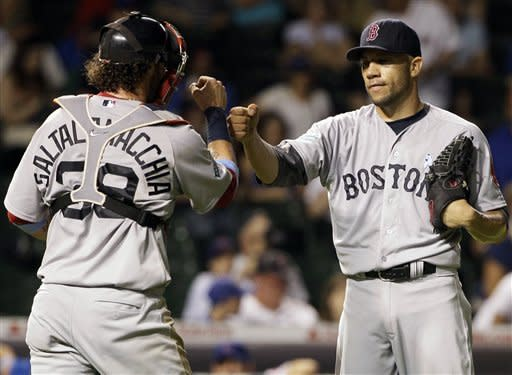 Boston Red Sox closer Alfredo Aceves, right, celebrates with catcher Jarrod Saltalamacchia after defeating the Chicago Cubs 7-4 during an interleague baseball game in Chicago, Sunday, June 17, 2012. (AP Photo/Nam Y. Huh)
