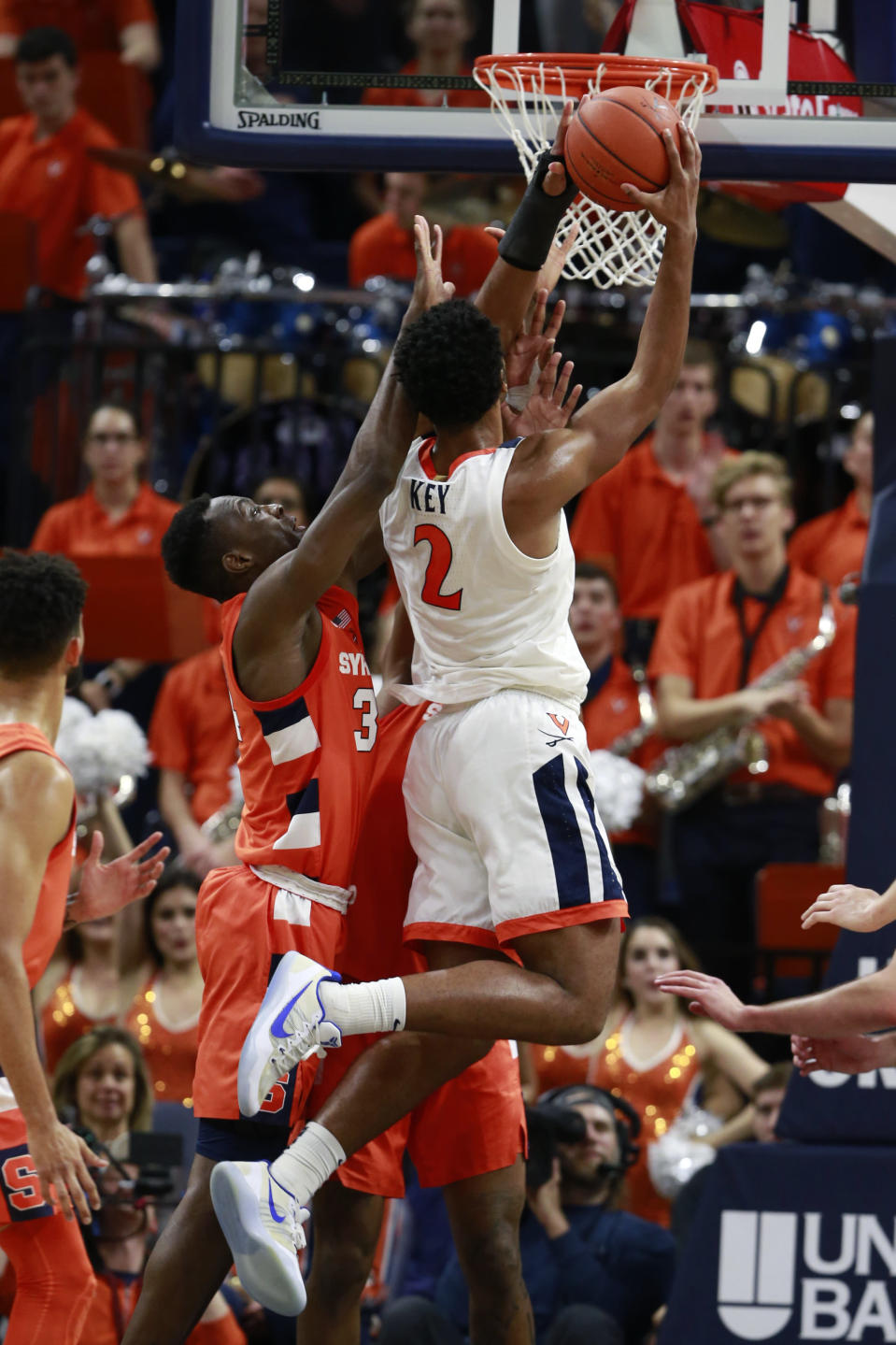 Virginia guard Braxton Key (2) puts up a shot in front of Syracuse forward Bourama Sidibe (34) during the first half of an NCAA college basketball game in Charlottesville, Va., Saturday, Jan. 11, 2020. (AP Photo/Steve Helber)