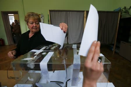 A woman votes in a polling station during parliamentary elections in Sofia, Bulgaria March 26, 2017.   REUTERS/Laszlo Balogh