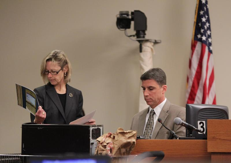 Middlesex County first assistant prosecutor Julia McClure shows print-outs of messages from Dharun Ravi's Blackberry to Robert Torrisi, an investigator with the Middlesex County Prosecutors Office, during Ravi's trial at the Middlesex County Courthouse in New Brunswick, N.J. on Wednesday, March 7, 2012. Ravi,a former Rutgers University student, is accused of using a webcam to spy on his roommate, Tyler Clementi, intimate encounter with another man. Days later Clementi committed suicide. Ravi, 19, faces 15 criminal charges, including invasion of privacy and bias intimidation, a hate crime punishable by up to 10 years in state prison. (AP Photo/The Star-Ledger, John O'Boyle, Pool)