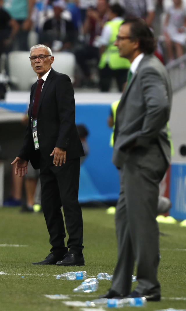 Saudi Arabia head coach Juan Antonio Pizzi, right, and Egypt head coach Hector Cuper watch the group A match between Saudi Arabia and Egypt at the 2018 soccer World Cup at the Volgograd Arena in Volgograd, Russia, Monday, June 25, 2018. (AP Photo/Darko Vojinovic)