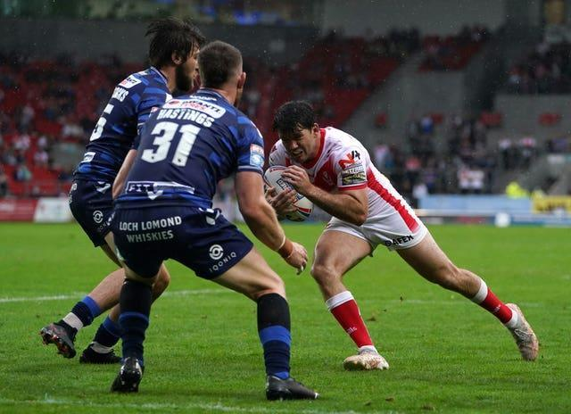Lachlan Coote, right, scored a try and six goals as St Helens beat Wigan 24-6 on Sunday at a rain-lashed Totally Wicked Stadium