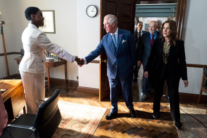 IVER HEATH, ENGLAND - JUNE 20: Prince Charles, Prince of Wales meets British actors Lashana Lynch (L) as he tours the set of the 25th James Bond Film at Pinewood Studios on June 20, 2019 in Iver Heath, England. The Prince of Wales, Patron, The British Film Institute and Royal Patron, the Intelligence Services toured the set of the 25th James Bond Film to celebrate the contribution the franchise has made to the British film industry. (Photo by Niklas Halle'n - WPA Pool/Getty Images)