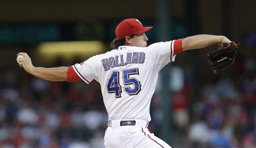 Texas Rangers starting pitcher Derek Holland (45) throws during the first inning of a baseball game against the Cleveland Indians Tuesday, June 11, 2013, in Arlington, Texas. (AP Photo/LM Otero)