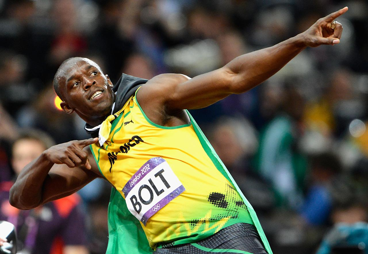 Usain Bolt of Jamaica celebrates after crossing the finish line to win the gold medal in the Men's 100m Final on Day 9 of the London 2012 Olympic Games at Olympic Stadium on August 5, 2012 in London, England.  (Photo by Pascal Le Segretain/Getty Images)