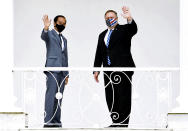 In this photo released by Indonesian Presidential Palace, Indonesian President Joko Widodo, left, and U.S. Secretary of State Mike Pompeo wave at photographers during their meeting at Bogor Presidential Palace in Bogor, West Java, Indonesia, Thursday, Oct. 29, 2020. Pompeo renewed the Trump administration's rhetorical onslaught against China in Indonesia on Thursday as the American presidential election looms. (Indonesian Presidential Palace via AP)