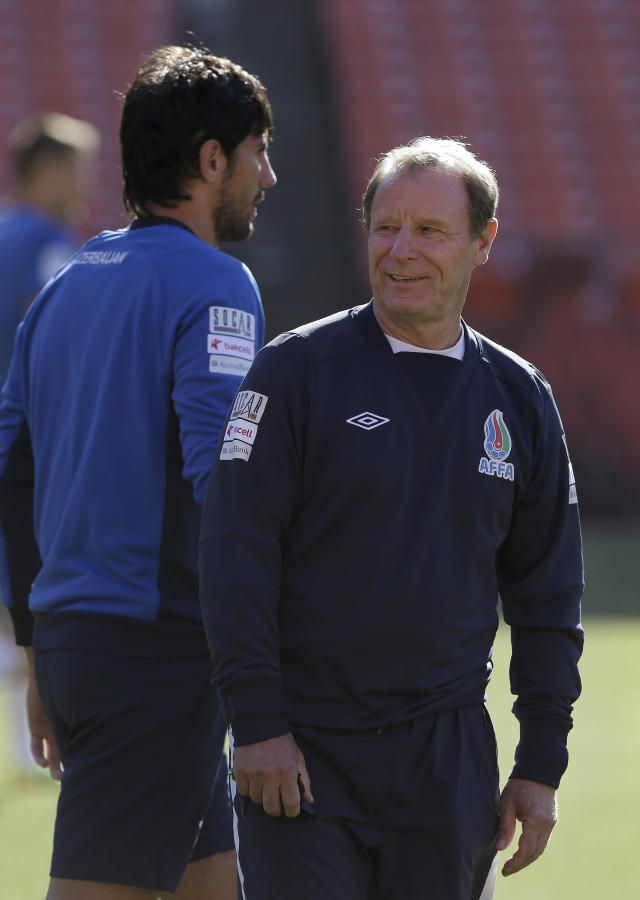 Azerbaijan soccer head coach Berti Vogts, right, watches as his team begins practice at Candlestick Park in San Francisco, Sunday, May 25, 2014. (AP Photo/Jeff Chiu)
