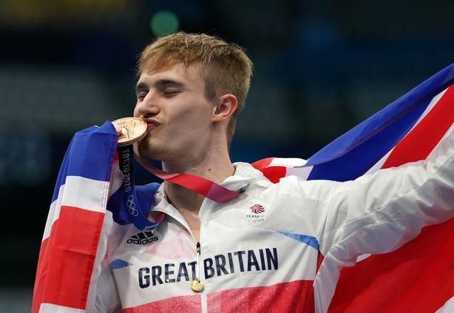 Great Britain's Jack Laugher celebrates winning the bronze medal