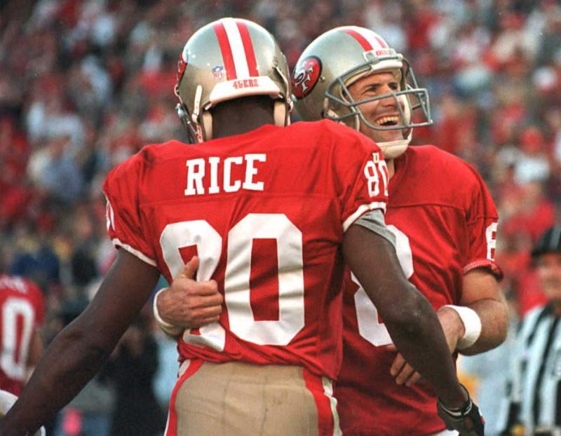 San Francisco 49ers quarterback Steve Young(R) hugs wide-receiver Jerry Rice(L)