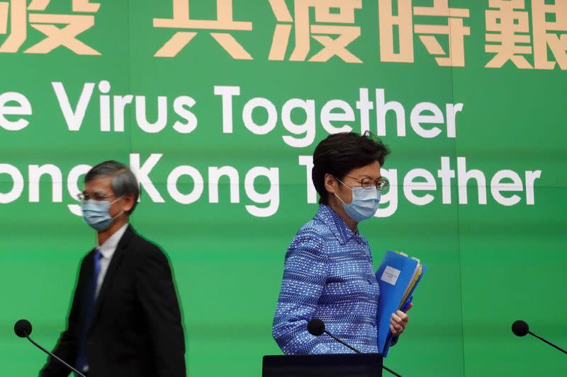 Hong Kong Chief Executive Carrie Lam wearing a face mask arrives for a news conference in Hong Kong