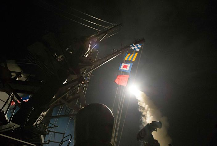 <p>A tomahawk missile is launched from the USS Ross on April 7, 2017, from the Mediterranean Sea. The United States blasted a Syrian air base with cruise missiles in retaliation for a chemical weapon attack against civilians. (U.S. Navy via AP) </p>