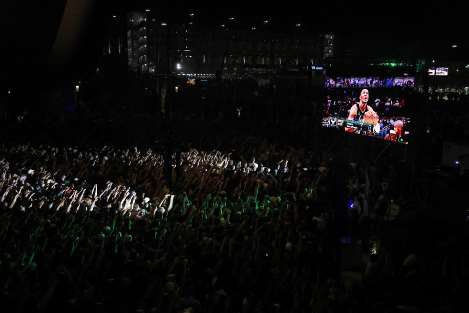 Fans watch television coverage of the Milwaukee Bucks and the Phoenix Suns playing in Game 6 of the NBA basketball finals Tuesday, July 20, 2021, in Milwaukee. (AP Photo/Jeffrey Phelps)