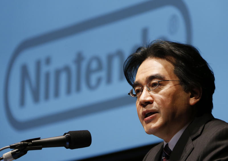 Nintendo Co. President Satoru Iwata speaks during a news conference in Tokyo, Thursday, Jan. 31, 2013. Iwata said the Japanese video-game maker will get back into operating profitability next fiscal year at more than 100 billion yen ($1 billion), and is ruling out price cuts for the new Wii U home console to boost sales. (AP Photo/Koji Sasahara)