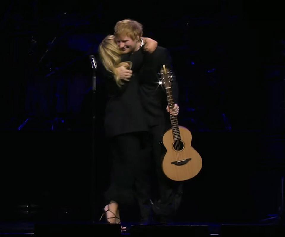 Kylie and Ed share a hug during their performance. Photo: YouTube/mushroomvideos.