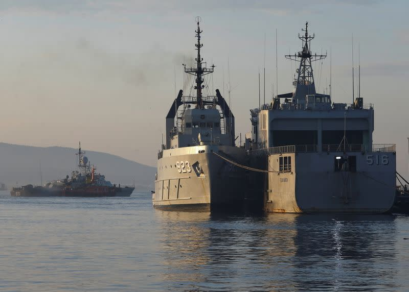 Indonesian Navy's ships are seen at the Tanjung Wangi port as the search continues for the missing KRI Nanggala-402 submarine
