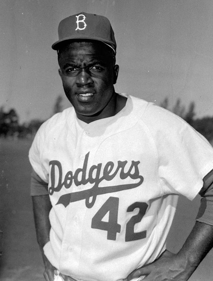FILE - This is a March 1956 file photo showing Brooklyn Dodgers baseball player Jackie Robinson in Vero Beach, Fla. All players, managers, coaches and umpires will wear No. 42 on Thursday, April 15, 2021, to celebrate Jackie Robinson Day, marking the anniversary of the date the Brooklyn Dodgers Hall of Famer made his Major League Baseball debut and broke the sport's color barrier in 1947. (AP Photo/File)
