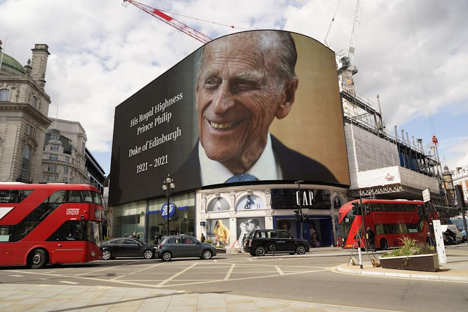 The electronic billboard at Piccadilly Circus displays a tribute to Britain's Prince Philip, Duke of Edinburgh in central London on April 9, 2021 after the announcement of the duke's death. - Queen Elizabeth II's husband Prince Philip, who recently spent more than a month in hospital and underwent a heart procedure, died on April 9, 2021, Buckingham Palace announced. He was 99. (Photo by Niklas HALLE'N / AFP) (Photo by NIKLAS HALLE'N/AFP via Getty Images)