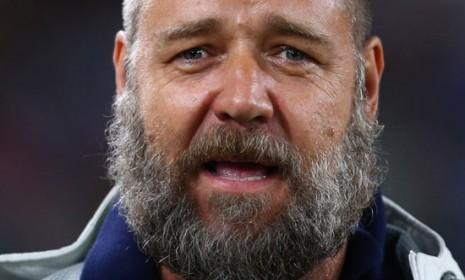 "Russell Crowe appears to be wearing the end of his nine-year marriage on his face, sporting a massive ""breakup beard"" while watching a rugby game in Sydney."