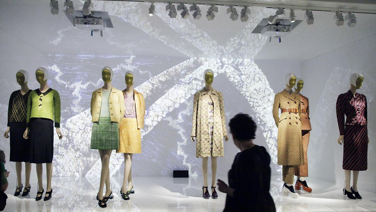 """Fashions by Elsa Schiarelli and Miuccia Prada are are on display at the Metropolitan Museum of Art, Monday, May 7, 2012 in New York. The show """"Schiaparelli and Prada, Impossible Conversations,"""" opens May 10 and continues through Aug. 19. (AP Photo/Mark Lennihan)"""