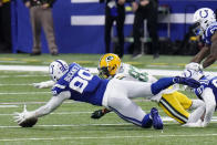 Indianapolis Colts' DeForest Buckner (99) recovers a fumble by Green Bay Packers' Marquez Valdes-Scantling (83) during overtime of an NFL football game, Sunday, Nov. 22, 2020, in Indianapolis. (AP Photo/AJ Mast)
