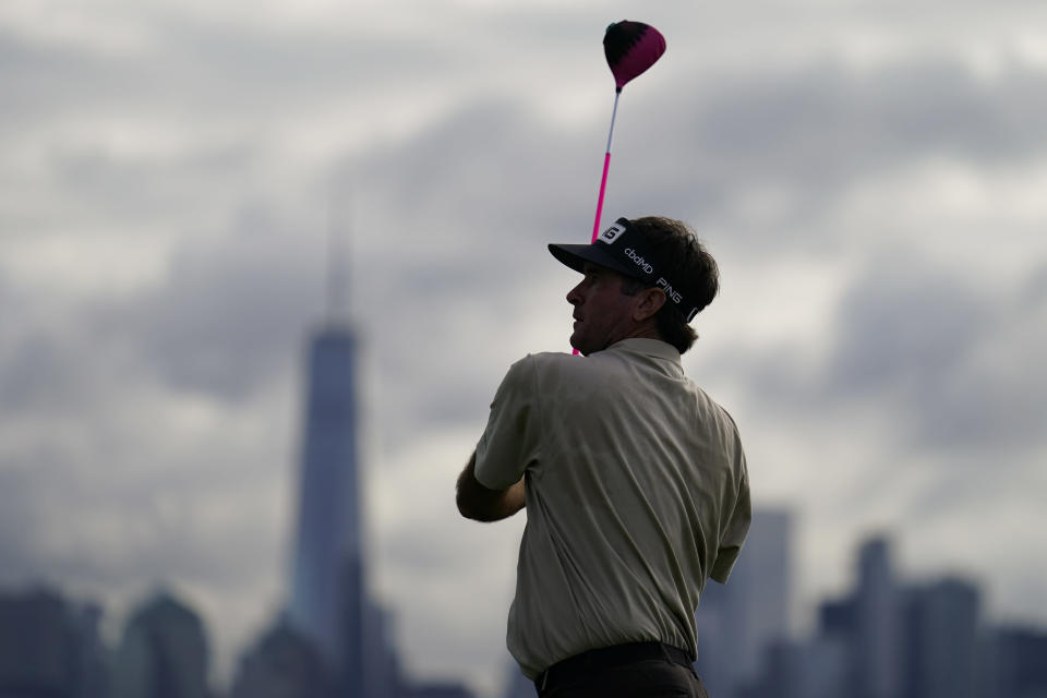 Bubba Watson watches his shot off the 15th tee in the first round of play at the Northern Trust golf tournament, Thursday, Aug. 19, 2021, at Liberty National Golf Course in Jersey City, N.J. (AP Photo/John Minchillo)