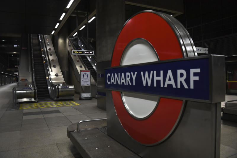 "An empty Canary Wharf station at what would normally be the morning rush hour in London, Tuesday, March 24, 2020. Britain's Prime Minister Boris Johnson on Monday imposed its most draconian peacetime restrictions due to the spread of the coronavirus on businesses and gatherings, health workers begged for more gear, saying they felt like ""cannon fodder."" For most people, the new coronavirus causes only mild or moderate symptoms. For some it can cause more severe illness. (AP Photo/Alberto Pezzali)"