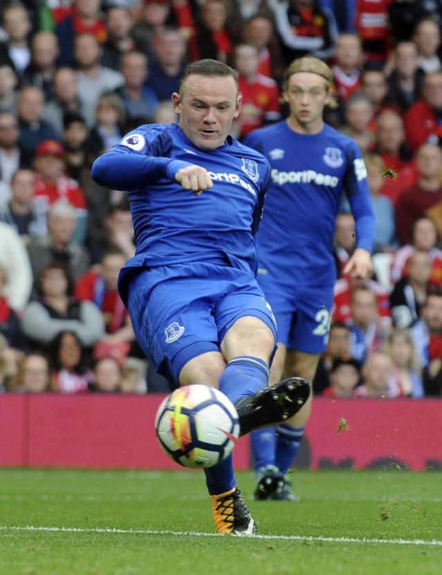 FILE - In this file photo dated Sunday, Sept. 17, 2017, Everton's Wayne Rooney attempts a shot at goal during the English Premier League soccer match between Manchester United and Everton at Old Trafford in Manchester, England. It is announced Tuesday Aug. 6, 2019, that 33-year old former England captain Wayne Rooney will be leaving US Major League Soccer team D.C. United to join second-tier English Championship team Derby County as player-coach from January 2020.(AP Photo/Rui Vieira, FILE)