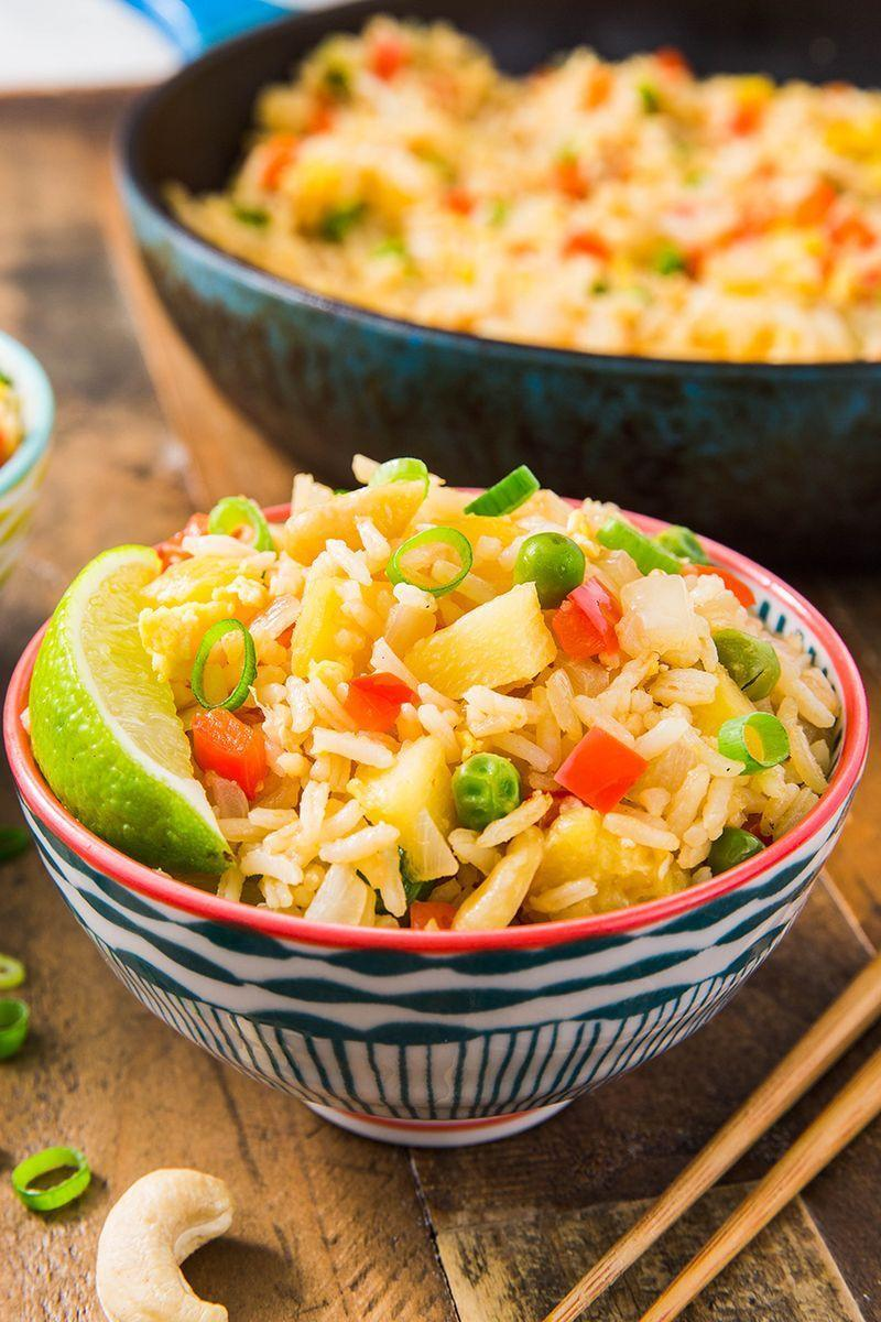 """<p>To give this rice more an island vibe, we fried the rice and veggies in coconut oil. If you don't have any on hand, use a vegetable oil instead. This stuff is seriously delicious. </p><p>Get the <a href=""""https://www.delish.com/uk/cooking/recipes/a30774801/easy-pineapple-fried-rice-recipe/"""" rel=""""nofollow noopener"""" target=""""_blank"""" data-ylk=""""slk:Pineapple Fried Rice"""" class=""""link rapid-noclick-resp"""">Pineapple Fried Rice</a> recipe. </p>"""