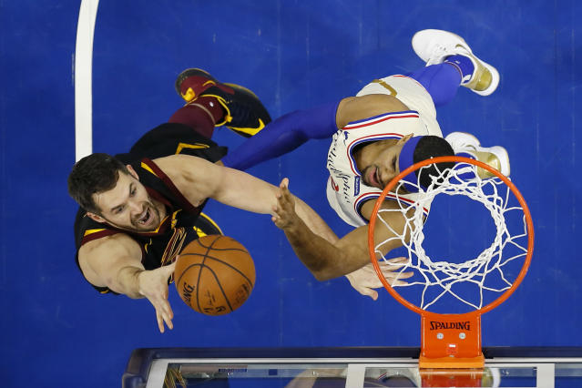 Cleveland Cavaliers' Kevin Love, left, goes up for a shot against Philadelphia 76ers' Tobias Harris during the first half of an NBA basketball game, Saturday, Dec. 7, 2019, in Philadelphia. (AP Photo/Matt Slocum)