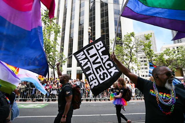 The Black Lives Matter and LGBTQ equality movements must support each other, note activists at the start of LGBTQ Pride Month. Here, in a scene from San Francisco Pride 2017, the messages intermingled. (Photo: Elijah Nouvelage/Getty Images)