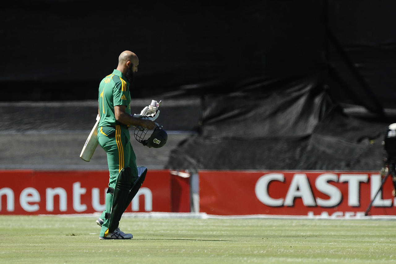 South Africa's opening batsman, Hashim Amla walks off the field after being caught LBW during the first One Day International (ODI) between South Africa and New Zealand on January 19, 2013 at Boland Park, in Paarl about 60Km North of Cape Town.  AFP PHOTO / RODGER BOSCH